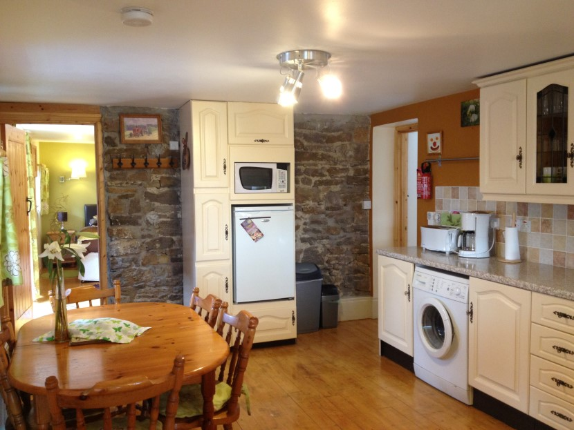 stables kitchen stone wall.JPG